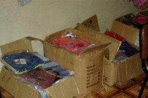 صور توزيع ألبسة العيد